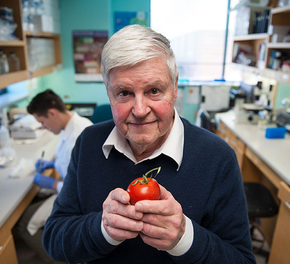 man in lab holding an apple