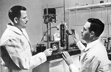 Charles B. Coggin, MD, and Olaf A. Bloomquist, MD, in a corner of their laboratory