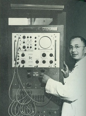 Edward H. G. Hon, MD with the electronic equipment he developed over a period of seven years, with the financial assistance of the National Institutes of Health.